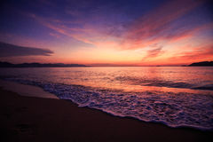 view of surf against fantastic dark blue red sky before sunrise Royalty Free Stock Photography