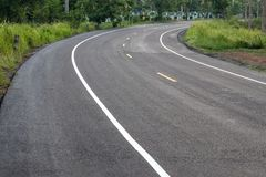 Curved road surface, which is new paved. Royalty Free Stock Image