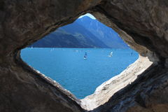 View of surfer in the hole. Lake Garda, Italy Royalty Free Stock Image