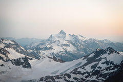 View of the surrounding Elbrus mountains from a height of 3800m at sunset. Photo from the slope of the Elbrus volcano royalty free stock photo