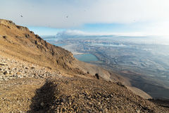 The view from the surrounding mountains to the city of Norilsk Stock Images