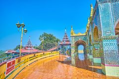 The way to the lower temple of Mandalay Hill, Myanmar. The view on surrounding terrace of Su Taung Pyae Pagoda and the covered staircase to the lower temples of royalty free stock photo