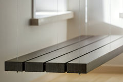 View of suspended bench in light interior Royalty Free Stock Image