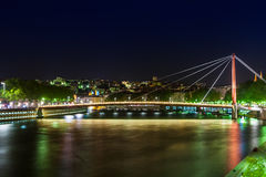 View of Suspension Bridge, Saone River at night, Lyon, France Stock Image