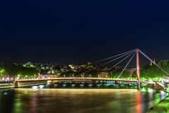 View of Suspension Bridge, Saone River at night, Lyon, France Stock Photos
