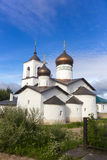 View on suspension bridge and St. Nicholas church in Ostrov Royalty Free Stock Image