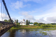 View on suspension bridge and St. Nicholas church in Ostrov Stock Image
