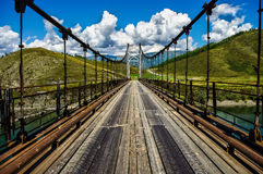 View of the suspension bridge on a sunny summer day Stock Photography