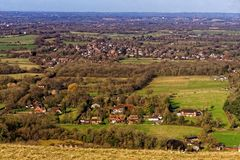 View of the Sussex Weald from the Downs. A view from the South Downs near Ditchling Beacon in Sussex, looking northwards over local villages of the Sussex Weald royalty free stock photography