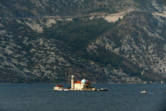 View on Sv.Djordje (left) and Gospa od Skrpjela ( right) alo known as Church Our Lady of the rocks in the morning. Perast, Monte Royalty Free Stock Photos