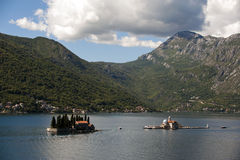 View on Sv.Djordje (left) and Gospa od Skrpjela ( right) alo known as Church Our Lady of the rocks in the morning. Perast, Monte Stock Photos