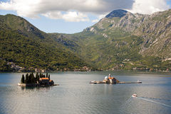 View on Sv.Djordje (left) and Gospa od Skrpjela ( right) alo known as Church Our Lady of the rocks in the morning. Perast, Monte Stock Photography