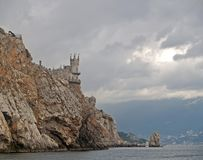 View of the Swallow`s nest lock in rainy day. Crimea.  royalty free stock images