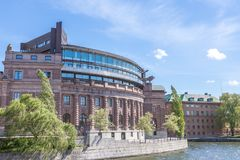 View of the Swedish Parliament. A Side-View of the Swedish Parliament Building (Riksdagen) with a Blue Cloudy Sky in the Background Royalty Free Stock Image