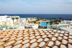 View on swimming pool and beach at luxury hotel Stock Photo