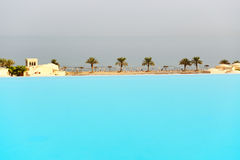 The view from swimming pool on a beach Royalty Free Stock Photos