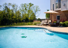 View of swimming pool and patio Royalty Free Stock Photo