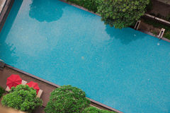A view of the swimming pool from the rooftop of my condo. This resort setting is great for a holiday and to swim in the clear blue. Waters. Keep your pool clean Royalty Free Stock Photo