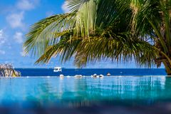 View from the swimming pool to the ocean. Maledives Royalty Free Stock Photo