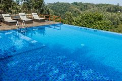 Salem,Yercaud,India, April 29 2017: swimming pool on top of a hill station. View of swimming pool on top of a hill station with mountain in the background royalty free stock photo