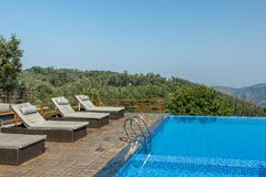 Salem,Yercaud,India, April 29 2017: swimming pool on top of a hill station. View of swimming pool on top of a hill station with mountain in the background royalty free stock photos