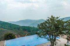 View of swimming pool on top of a hill station with mountain in the background, Salem, Yercaud, tamilnadu, India, April 29 2017 Royalty Free Stock Image