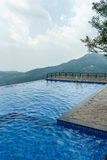 View of swimming pool on top of a hill station with mountain in the background, Salem, Yercaud, tamilnadu, India, April 29 2017. View of swimming pool on top of royalty free stock image