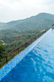 View of swimming pool on top of a hill station with mountain in the background, Salem, Yercaud, tamilnadu, India, April 29 2017. View of swimming pool on top of stock photo