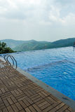 View of swimming pool on top of a hill station with mountain in the background, Salem, Yercaud, tamilnadu, India, April 29 2017. View of swimming pool on top of royalty free stock images