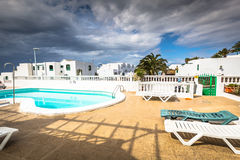 View of the swimming pool in the urbanization Playa Blanca,Lanza. Rote Royalty Free Stock Images