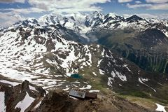 View of Swiss Alps in Summer. (with Bernina Mountain Range on the Horizon Royalty Free Stock Photography