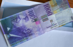 View of the Swiss francs currency on the mailer Royalty Free Stock Photo