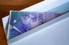 View of the Swiss francs currency on the mailer Stock Image
