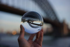 View of Sydney Bridge through a crystal ball Royalty Free Stock Images