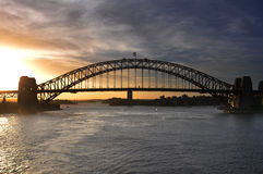 View of Sydney Harbour Bridge at sunset. Taken from P and O Aurora, on a world cruise Royalty Free Stock Photo