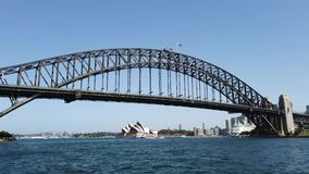 Sydney Harbour Bridge and Opera House, View From Harbour North Shore, Australia. View of Sydney harbour, Harbour Bridge from a boat or ferry sailing west along stock video footage