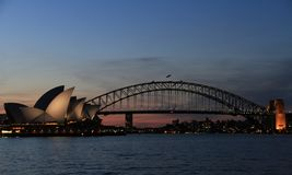 View of Sydney opera house and harbour bridge at dusk from Mrs Macquarie`Chair, Sydney, New South Wales, Australia. Sydney, capital of New South Wales and one of royalty free stock photo