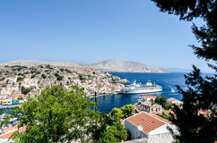 View on the Symi island harbor with cruise ship Royalty Free Stock Images