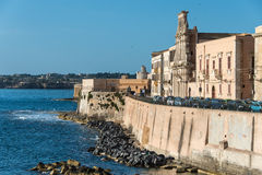 View of Syracuse, Ortiggia, Sicily, Italy, houses facing the sea. Panorama Syracuse, Ortiggia, Sicily, Italy, houses facing the sea in the morning, in the Royalty Free Stock Photography
