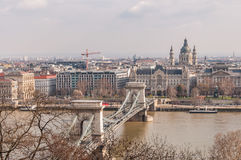View of the Szechenyi Chain Bridge and church St. Stephen`s in Budapest Royalty Free Stock Image
