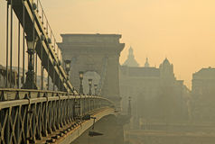 View from Szechenyi Chain Bridge in the fog, Budapest, Hungary. View from Szechenyi Chain Bridge on Four Seasons Hotel Gresham Palace in the fog, Budapest Royalty Free Stock Photography