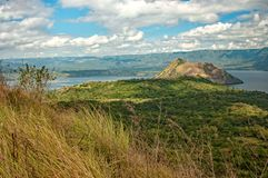 View Of The Taal Volcano with blue sky and white clouds royalty free stock photography