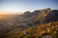 View of Table Mountain Capetown South Africa. A view of Table Mountain Capetown from the top of Lionshead Stock Photo