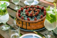 View of a table during party. Summer party, birthday cake and mojito drinks Stock Photography