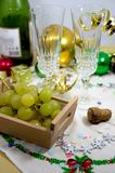 View of a table ready to celebrate Christmas whit some glasses of champagne or cava, lucky grapes. View of a table ready to celebrate Christmas where you can see royalty free stock images
