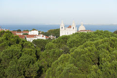 View of the Tagus river in Lisbon with church over trees Royalty Free Stock Photos