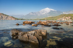 View of Tahtali mountain from the bay in Phaselis, Turkey. Top of Tahtali mountain. View from the sea bay in the ancient city of Phaselis. Tourist attraction of Stock Images