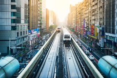 View of Taipei city with metro train approaching Station. Royalty Free Stock Photo