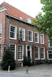 View on tall windows in a house facade in leiden south holland netherlands royalty free stock images
