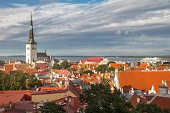 View of Tallinn Old Town, Baltic Sea and St. Olaf in a summer day, Estonia. Aerial View of Tallinn Old Town, Baltic Sea and St. Olaf in a summer day, Estonia Stock Images